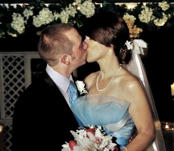 Bride and Groom kiss with blue dress