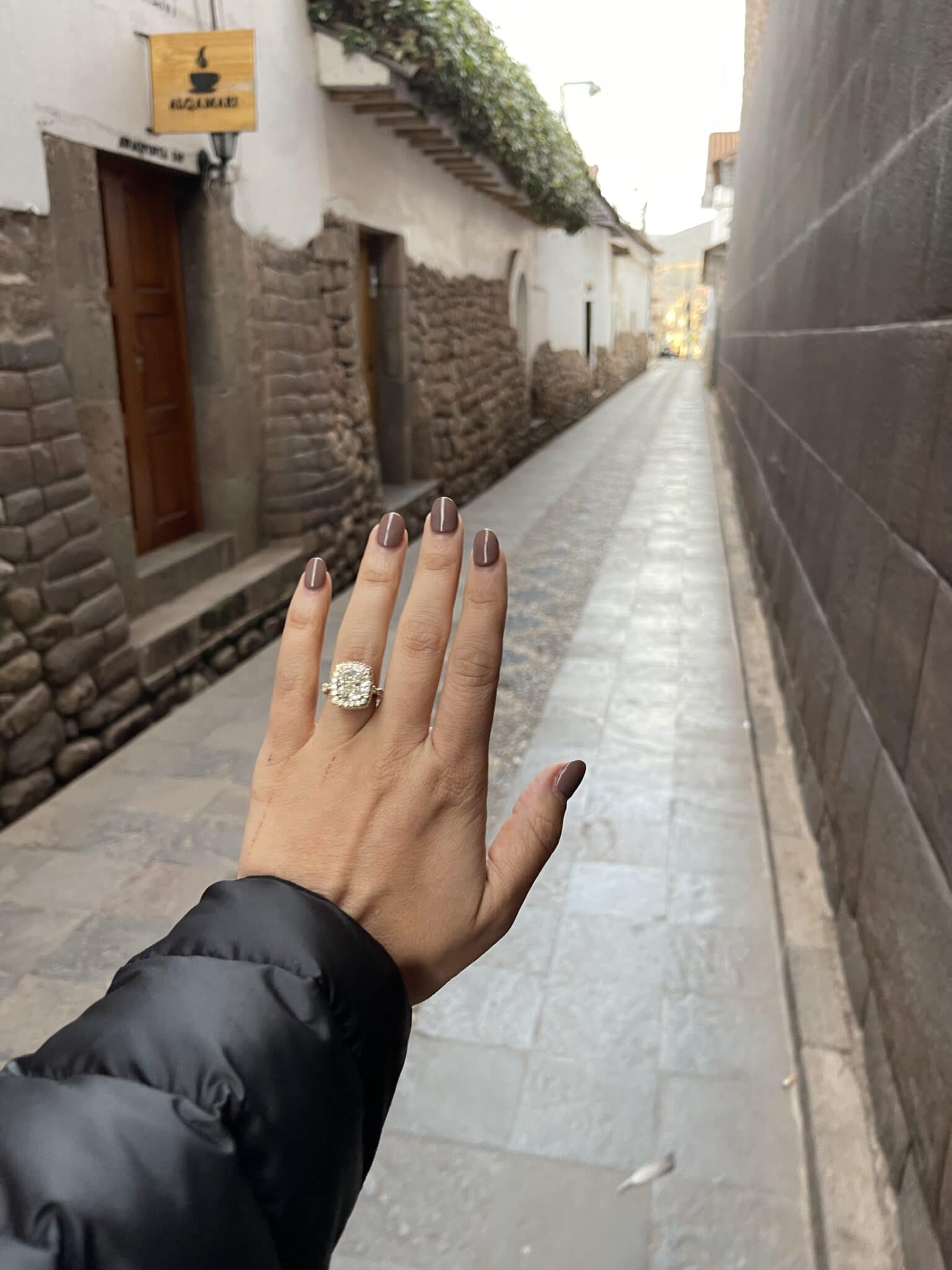the bride's left hand with her new engagement ring after the machu picchu marriage proposal.