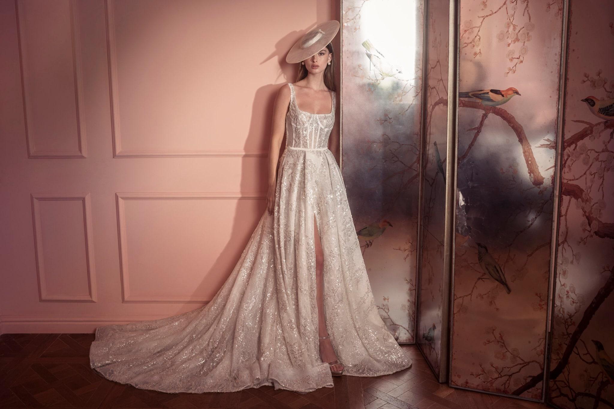 bride in sparkling wedding dress and wide brim hat