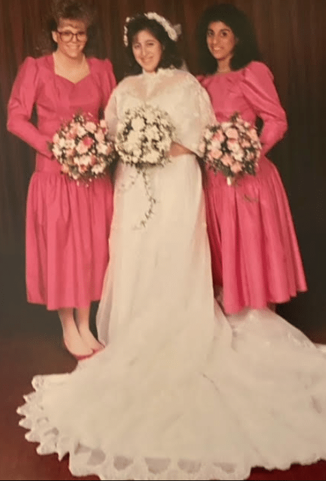bride with pink dressed bridesmaids