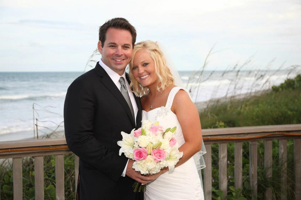 Bride and Groom on beach walkway