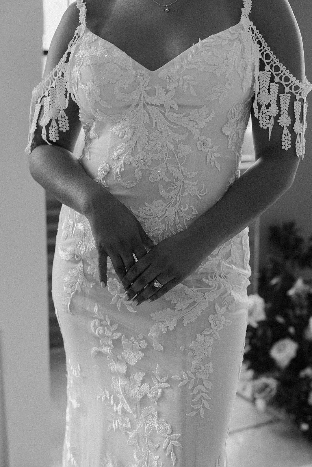 a close up of the bride's wedding dress for the urban loft wedding inspiration shoot.