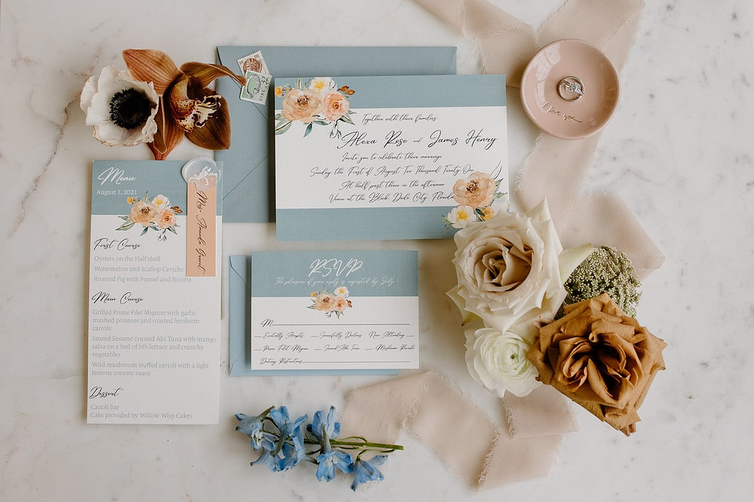 the invitation for the urban loft wedding inspiration shoot featuring light blues and natural tones.