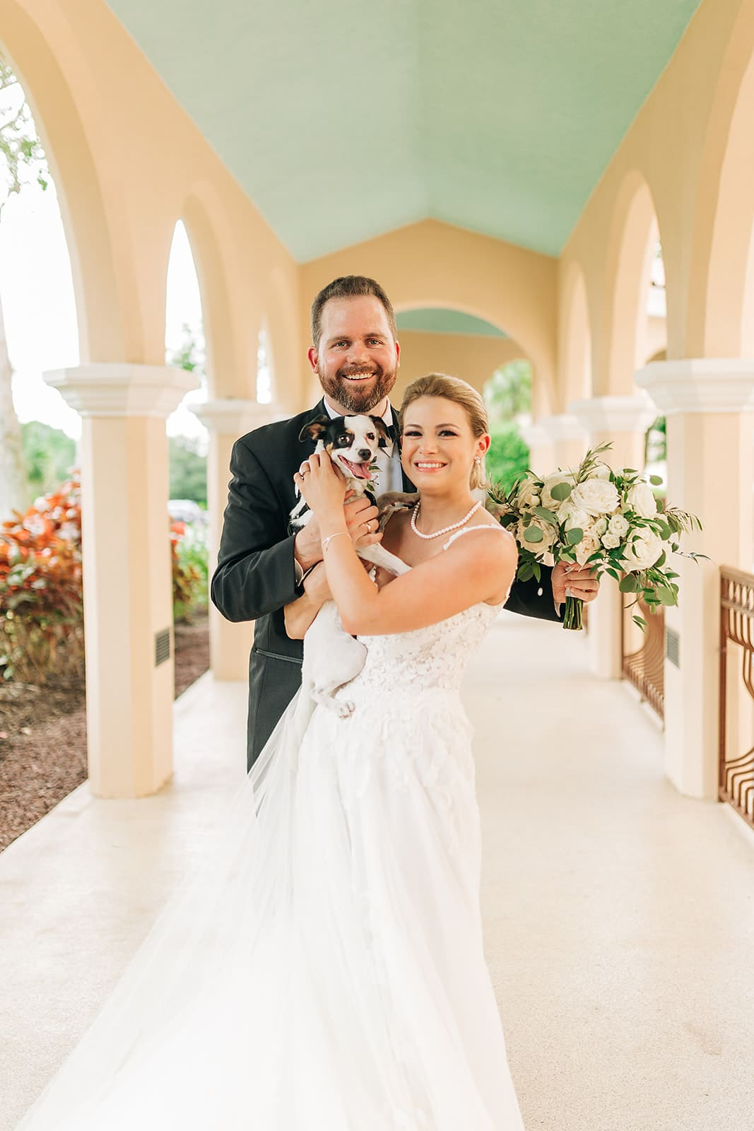 Bride and Groom with pet dog.