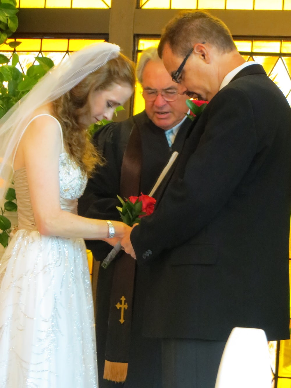 Wedding couple with officiant.