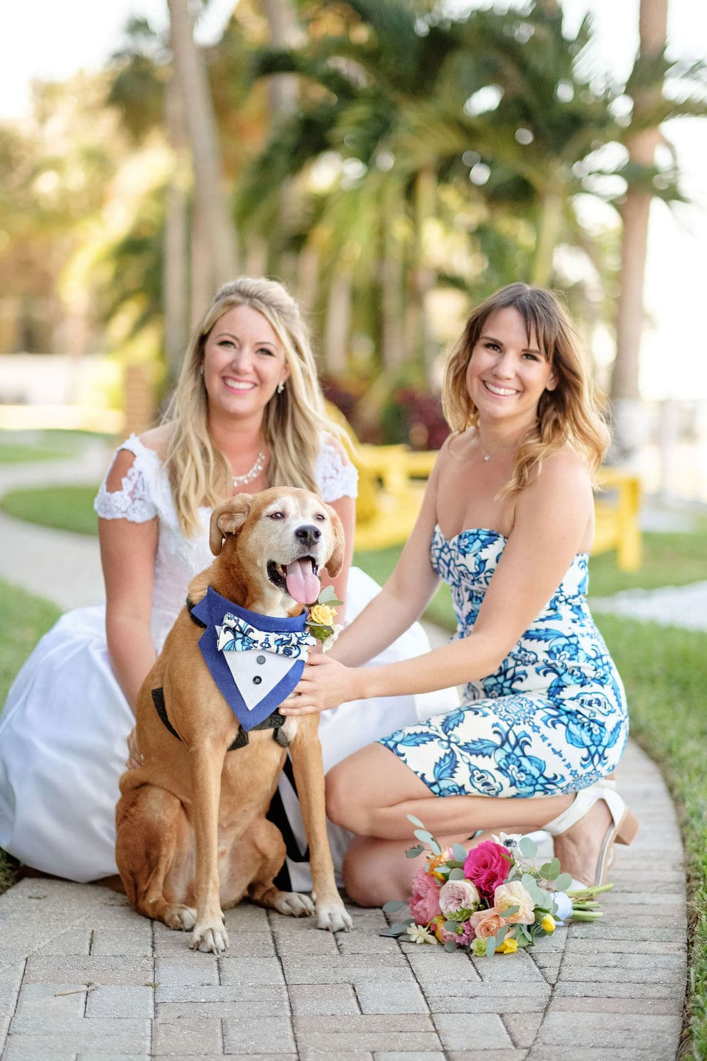 Bride and Bridesmaid with dog with bowtie