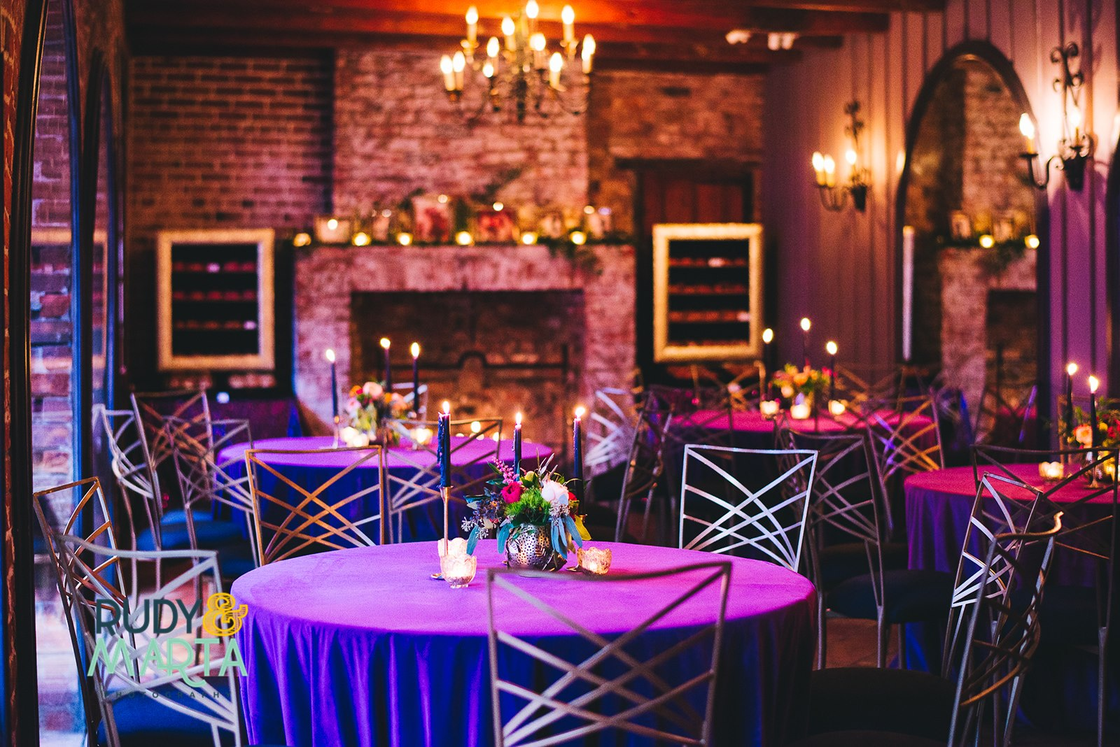 New Orleans wedding reception, purple and feather centerpieces